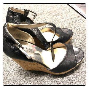 Michael Kors (MK) wedge sandals in black.